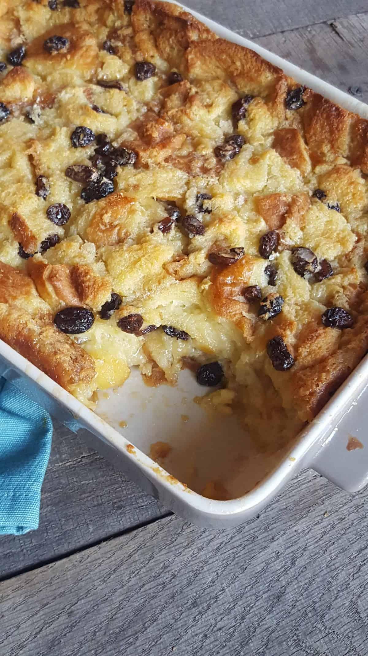 Bread Pudding with raisins in white casserole dish