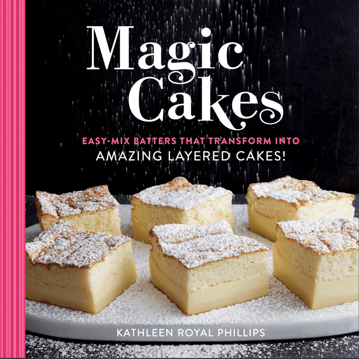 Cover of Magic Cakes cookbook with squares of powdered sugar dusted custard cakes