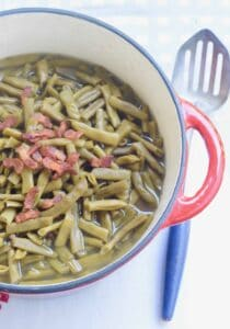 Rattlesnake green beans with bacon in red pot and antique spoon