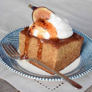 Fig Jam Cake with whipped cream, fig half and Fig and Lemon Preserves drizzled.