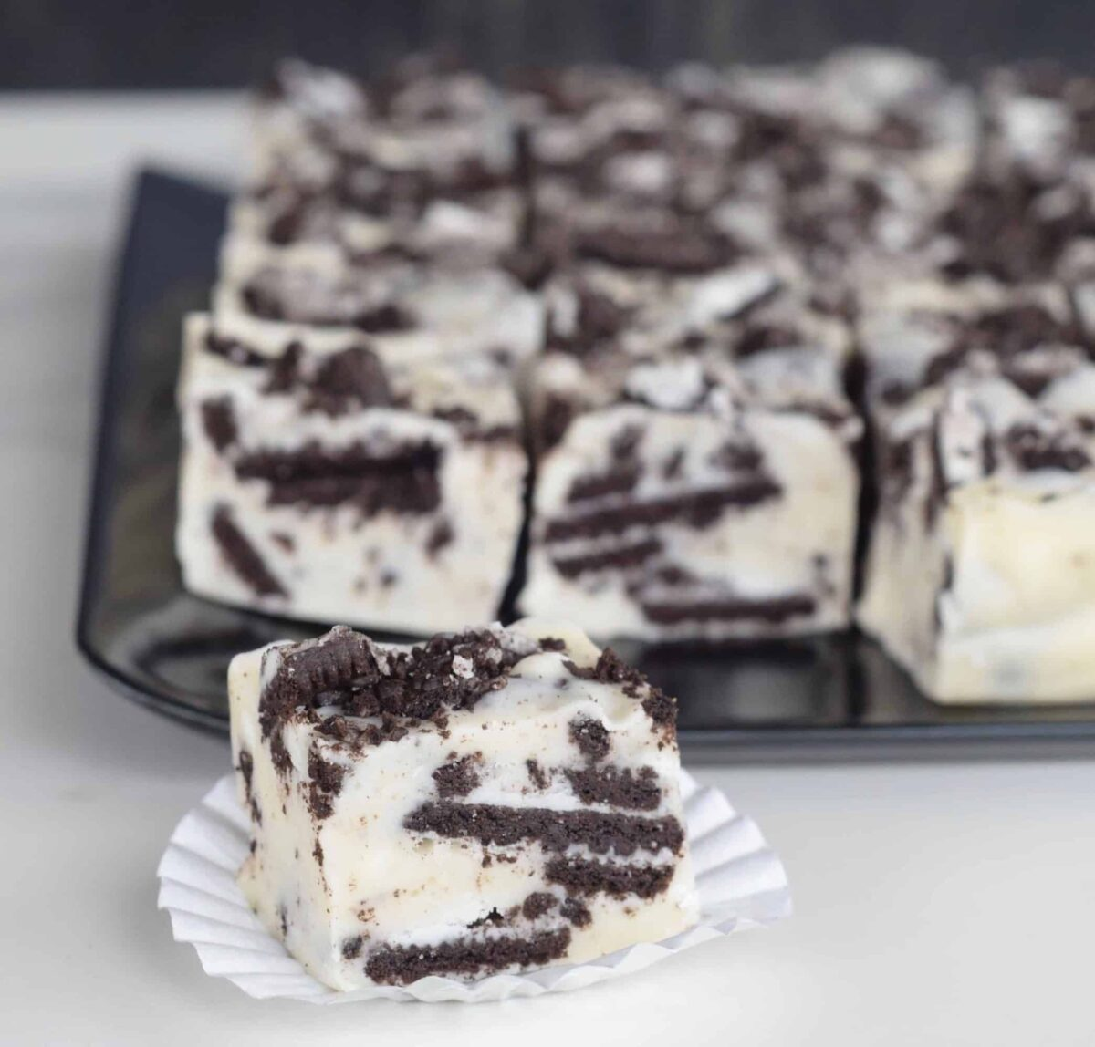 Cookies n Cream White Chocolate Fudge cut into squares revealing the yummy crushed Oreo cookies