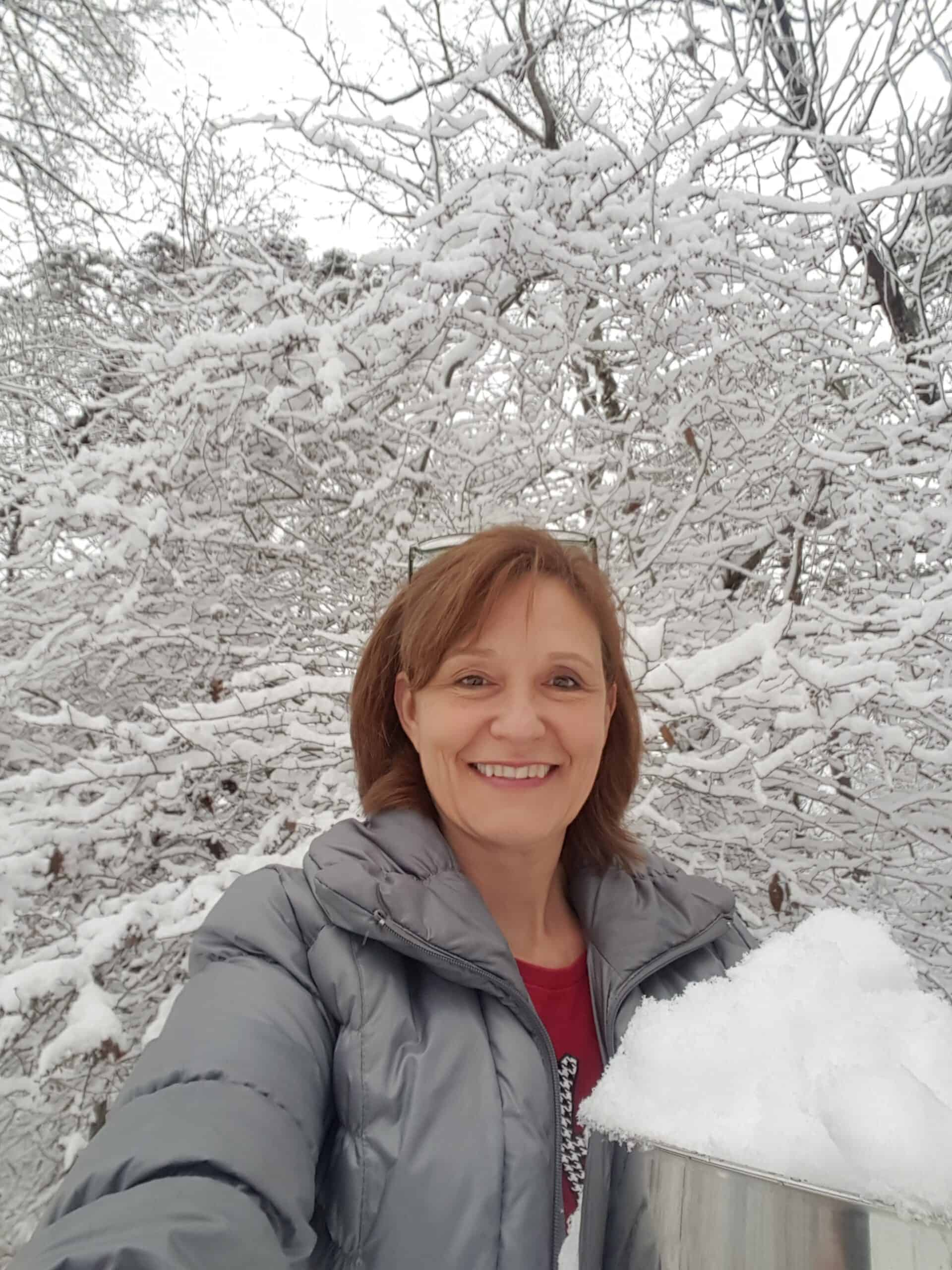 Woman holding bowl of snow