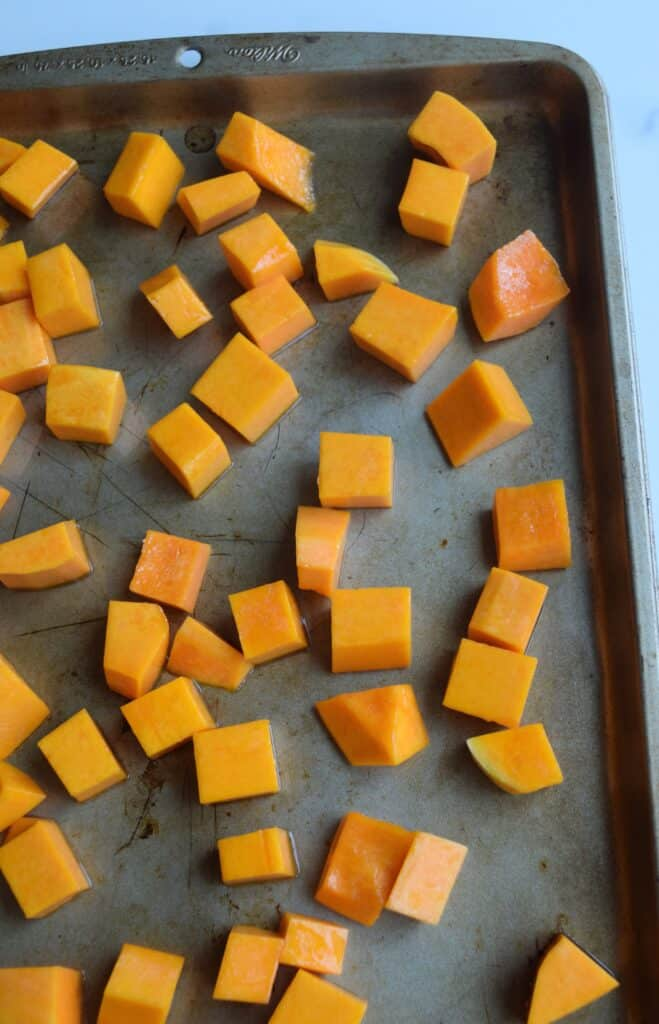 cubed butternut squash on a cookie sheet