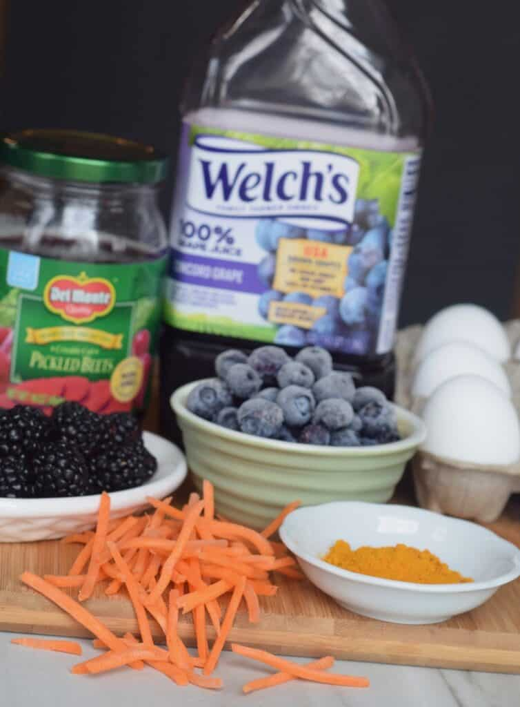 Natural dyes for Easter eggs: pickled beets, black berries, blueberries, turmeric and grape juice.