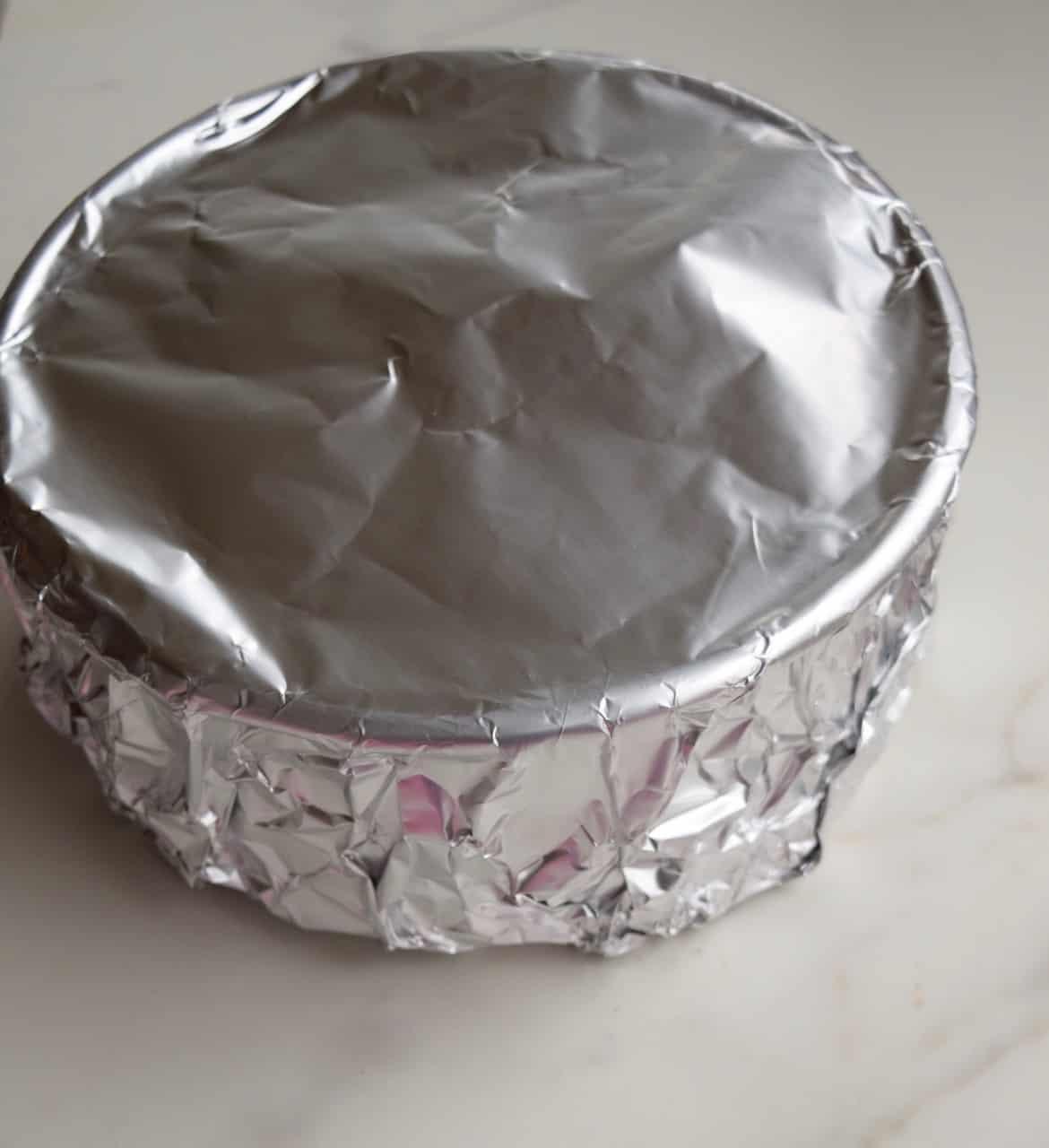 Aluminum foil covering a cake pan