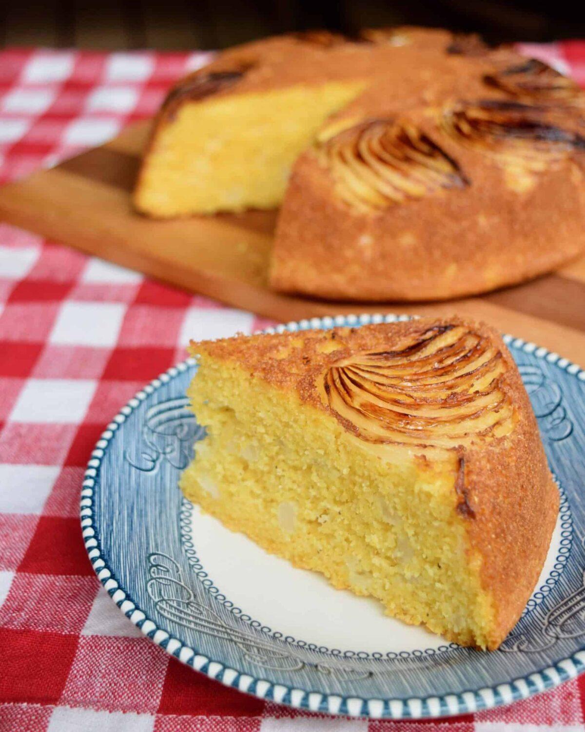 vidalia onion cornbread wedge on blue plate with cornbread in background on wooden cutting board