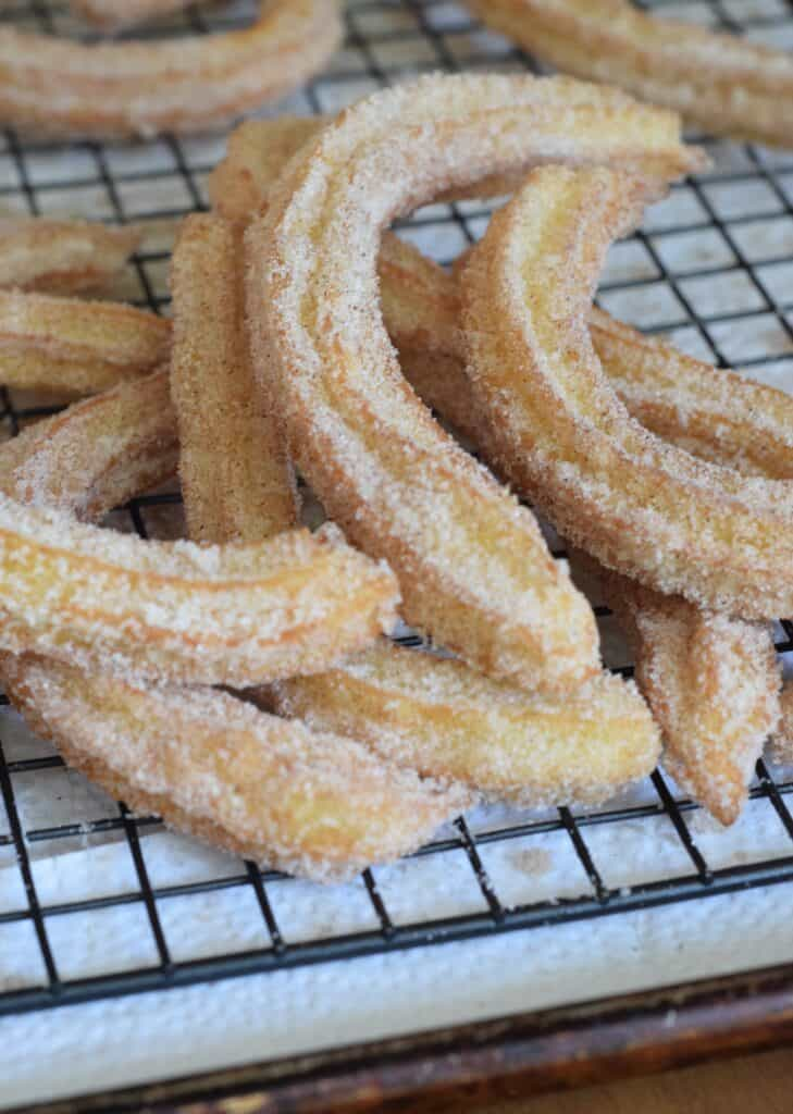 Churros with Vanilla Dipping Sauce. They are crisp on the outside, soft and tender on the inside. On a wire rack over paper towels.