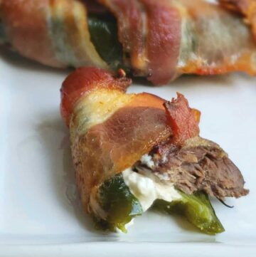 Close up Bacon Wrapped Dove Jalapeno poppers on a white platter Thanksgiving