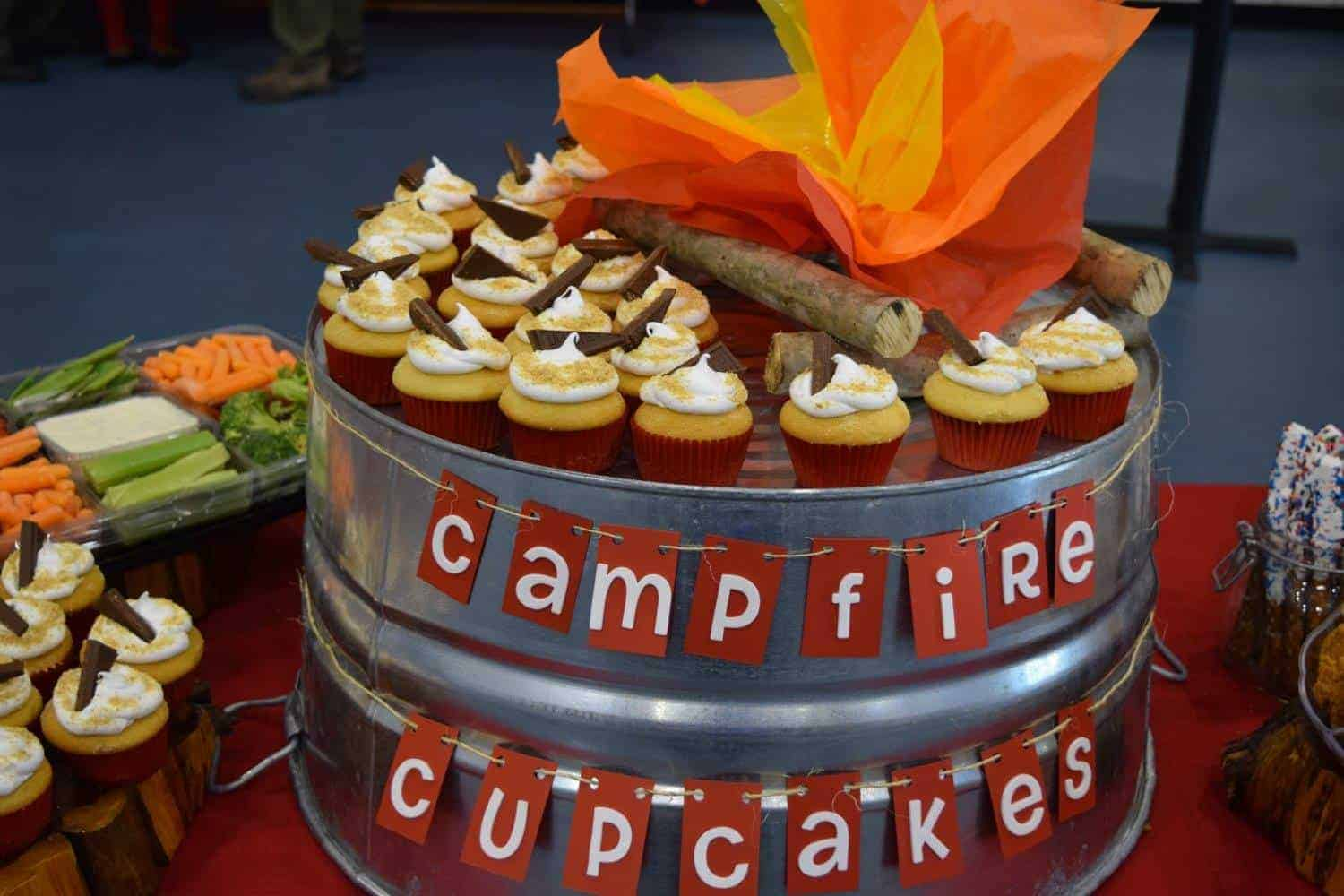 smores cupcakes on a metal tub with words Campfire Cupcakes strung across