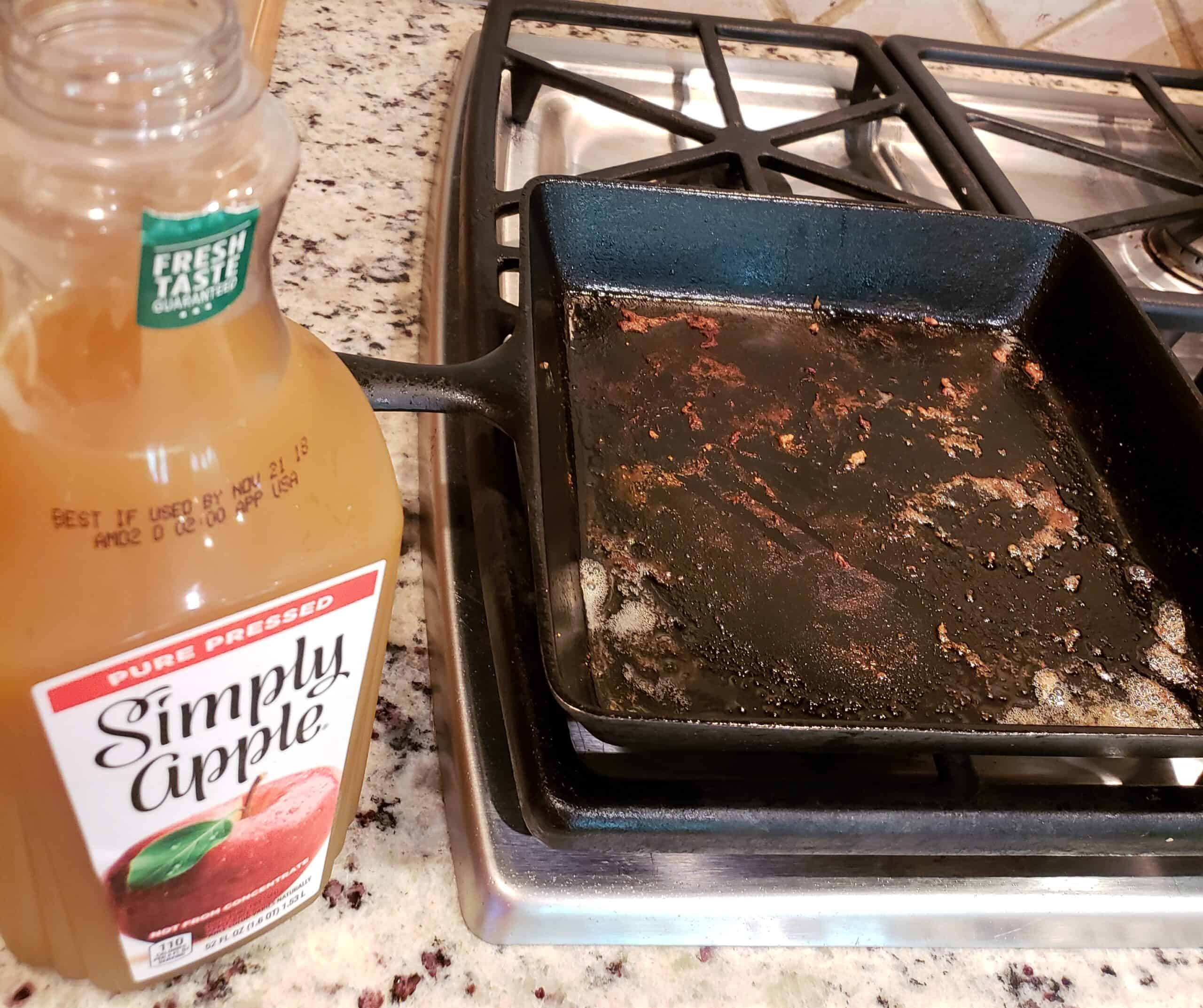 Pan Seared Pork Chops browned bits and Simply Cider jug