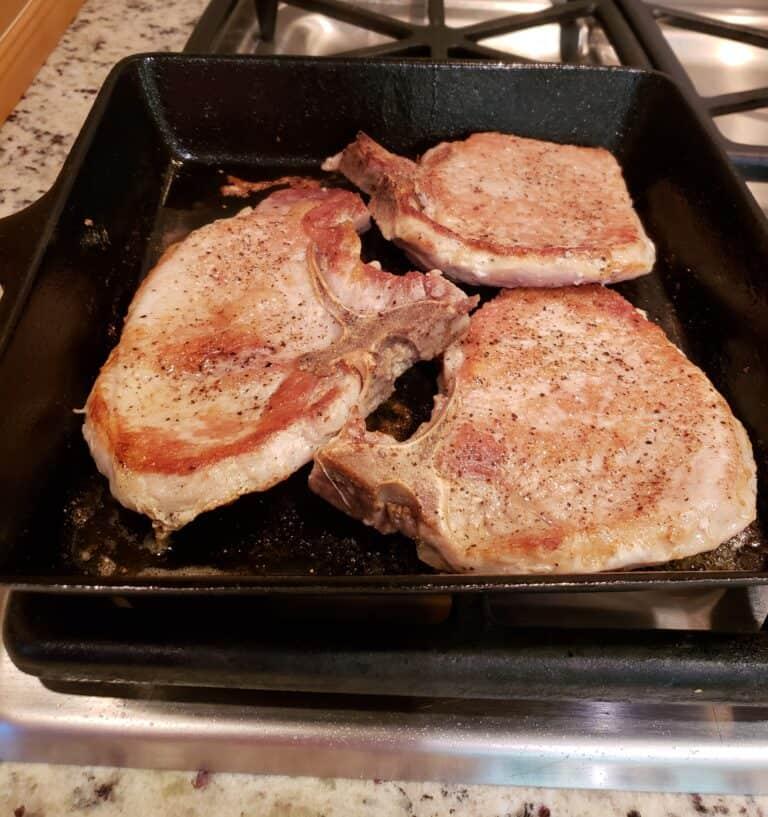 Pan Seared Pork Chops browned in skillet