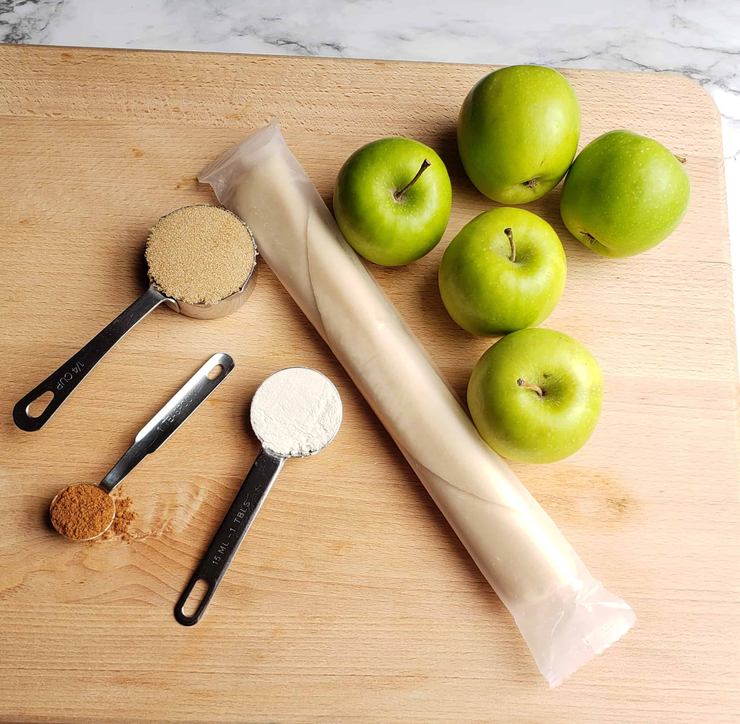 Pie crust rolled up with apples and spices