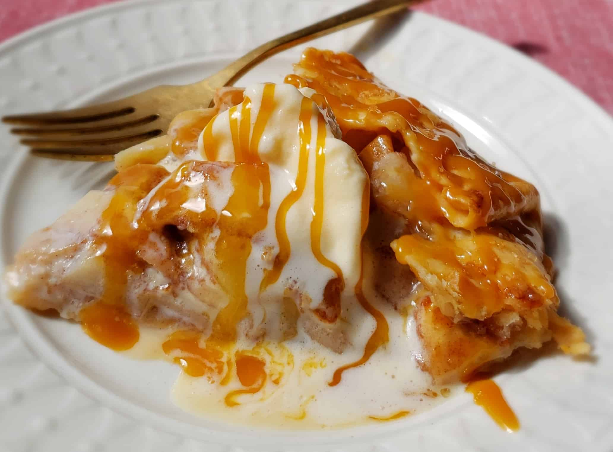 apple galette slice with ice cream on little white plate