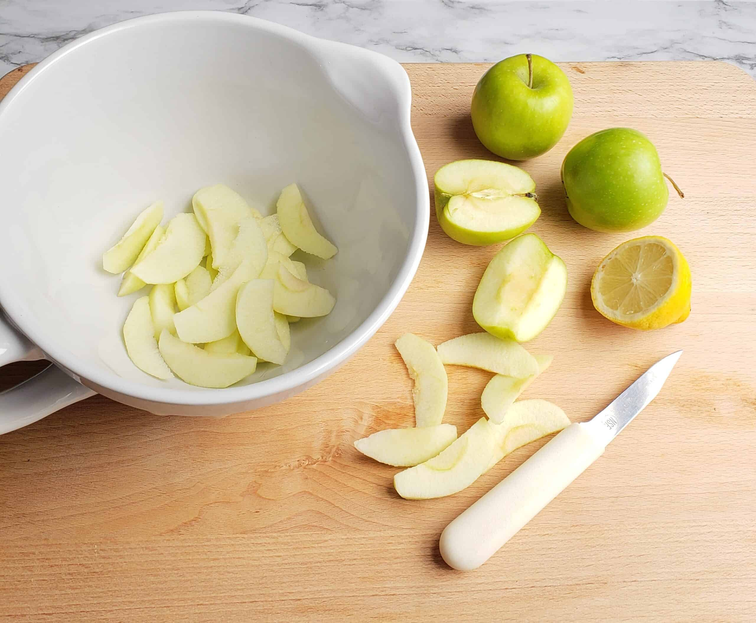 apple galette slicing apples and in bowl