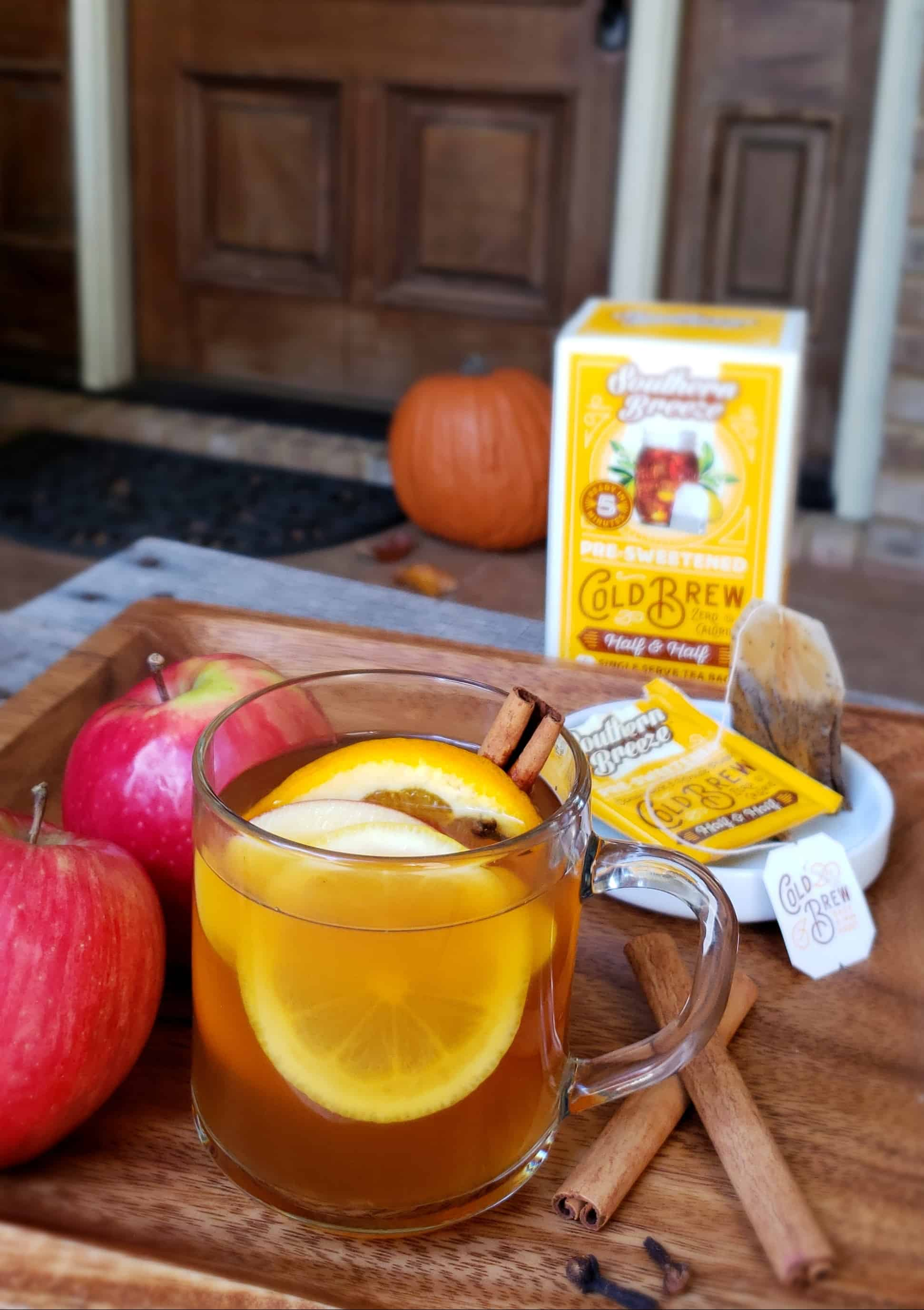 Southern Breeze mulled sweet tea apple cider on front porch with a pumpkin