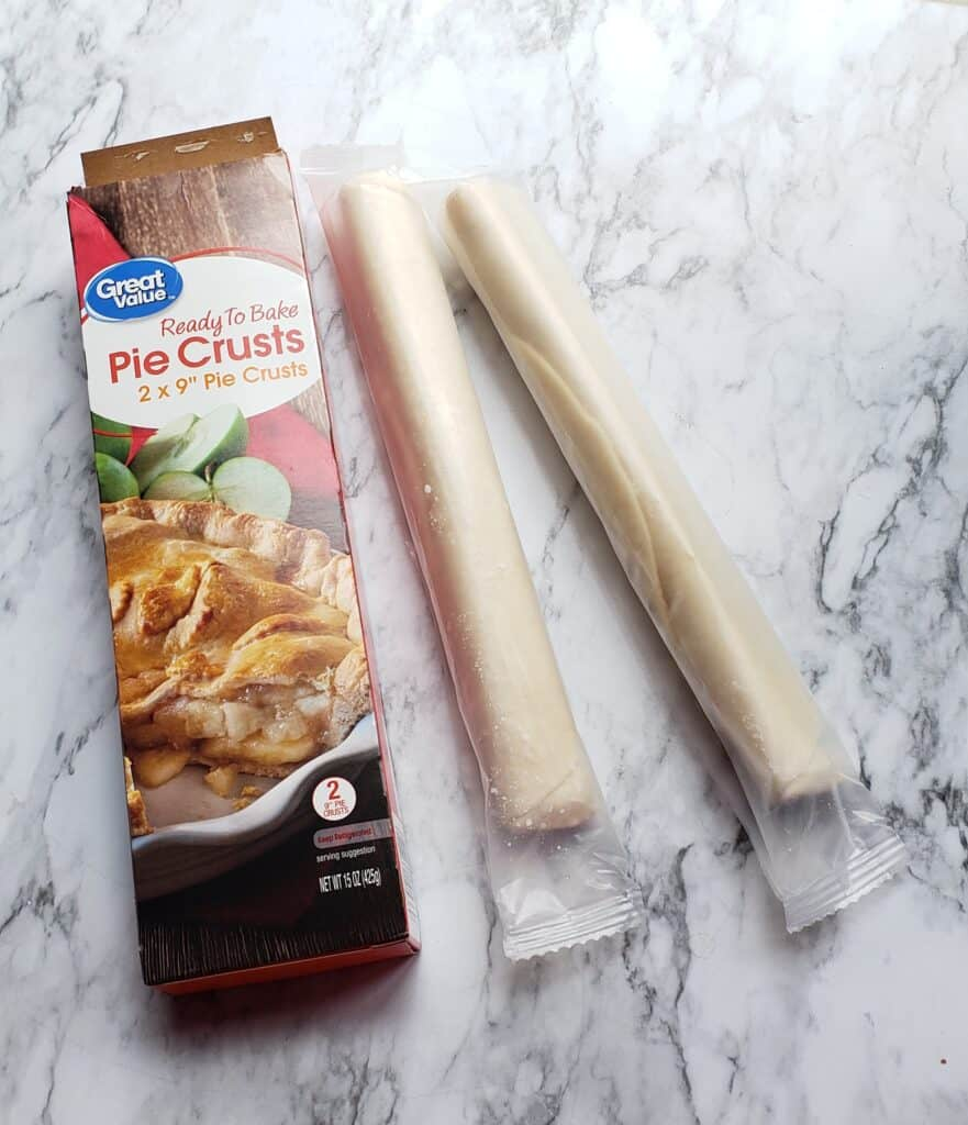 Great Value Pie Crust rolls on marble surface