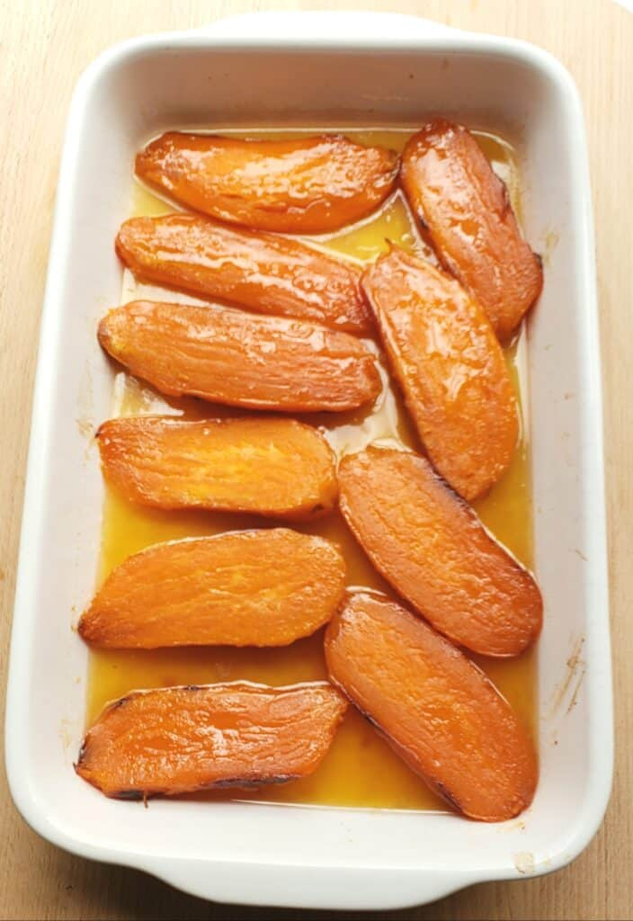 Candied Sweet potatoes in a white casserole