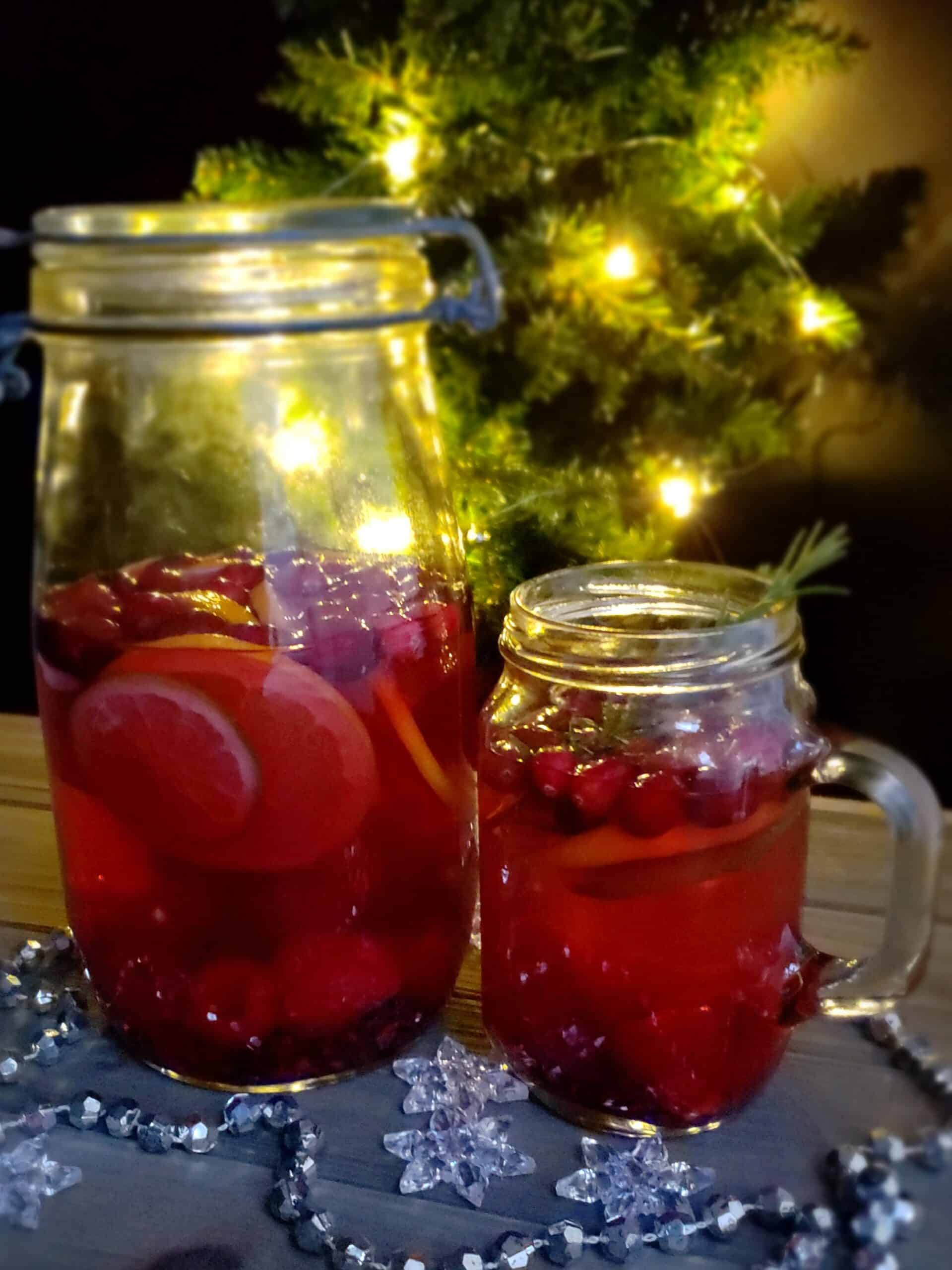"""Serve Sweet Tea Sangria """"Skinny"""" Mocktail at a Christmas tree trimming party at night."""