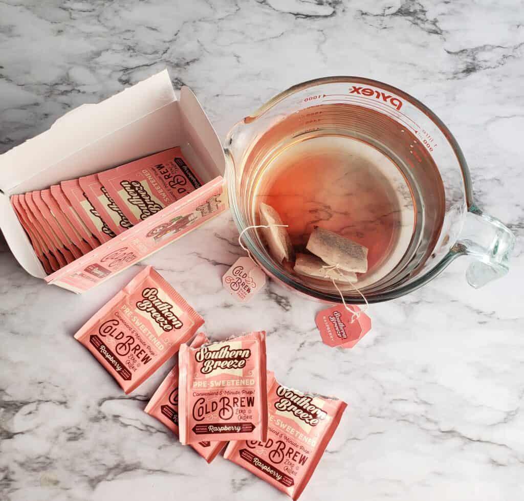 Steep 4 raspberry flavored Southern Breeze presweetened tea bags in 4 cups of water