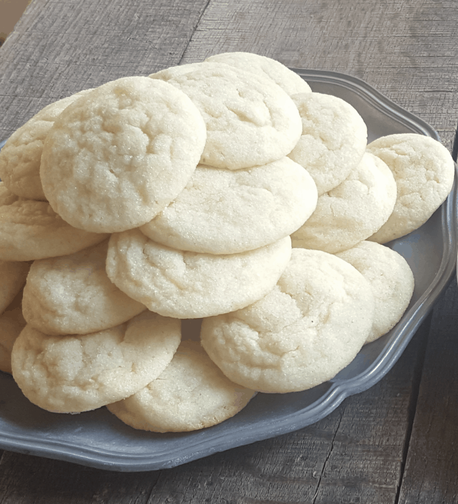 A plate full of Sugardoodles-A cross between a sugar cookie and a Snickerdoodle.