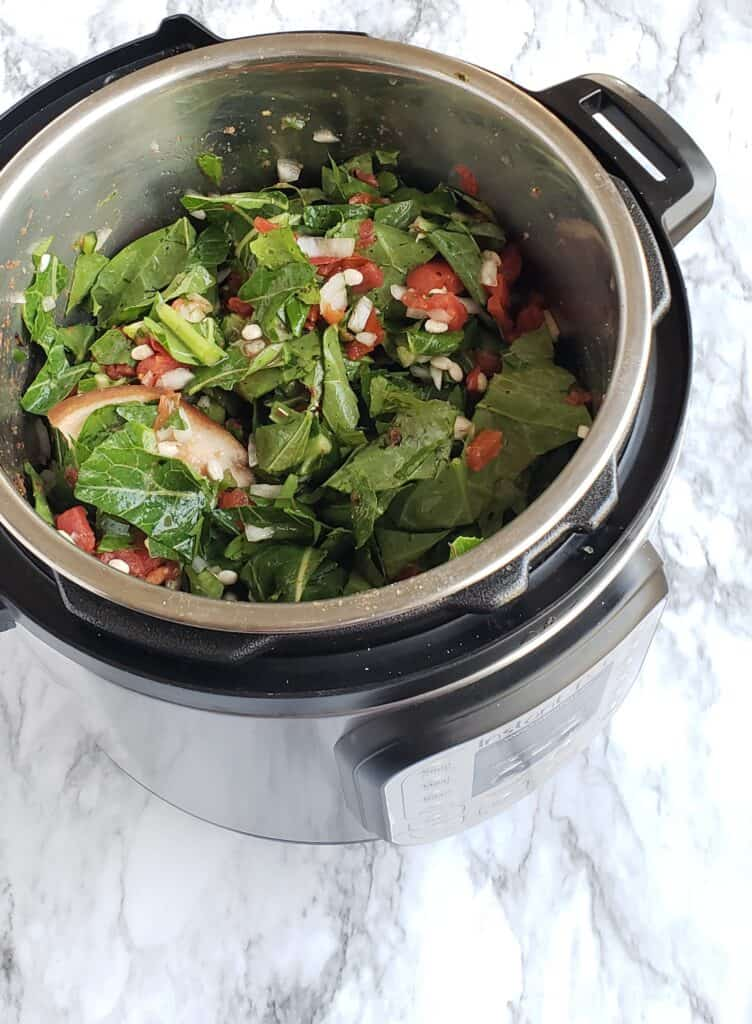 Toss all the ingredients for Instant Pot Collard Greens and Navy Beans together in the Instant Pot before turning on the Instant Pot