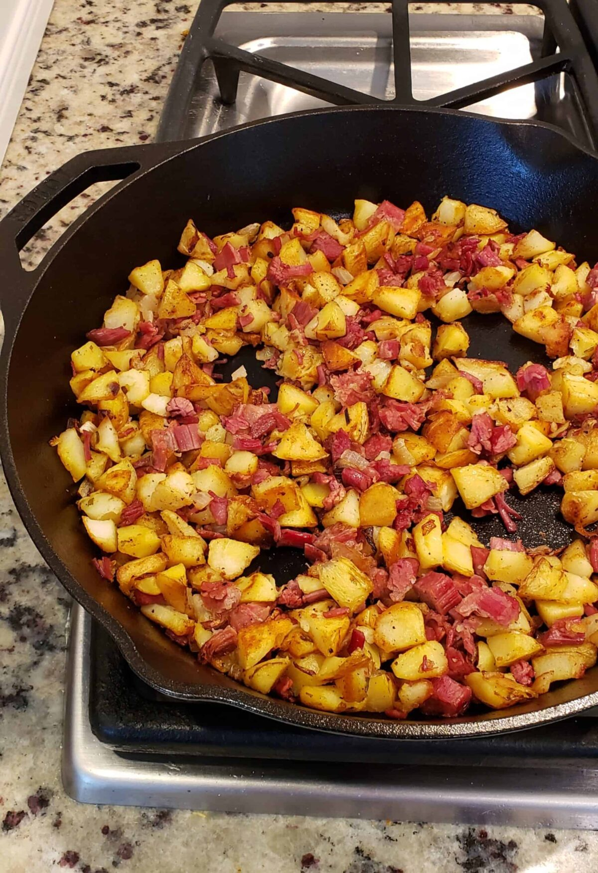 corned beef hash with circles created by pushing hash around