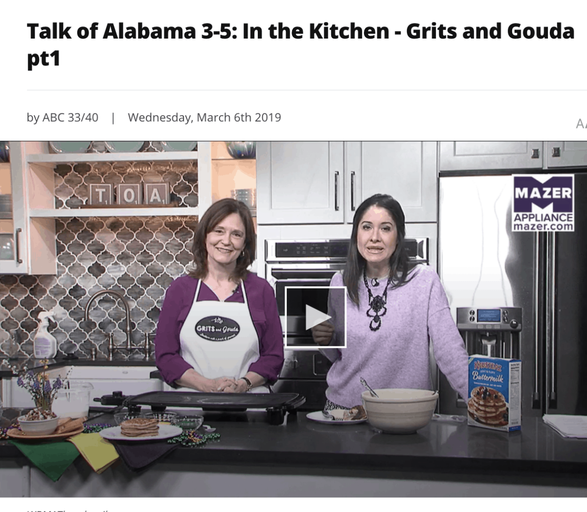Two women behind a kitchen counter and pancake griddle
