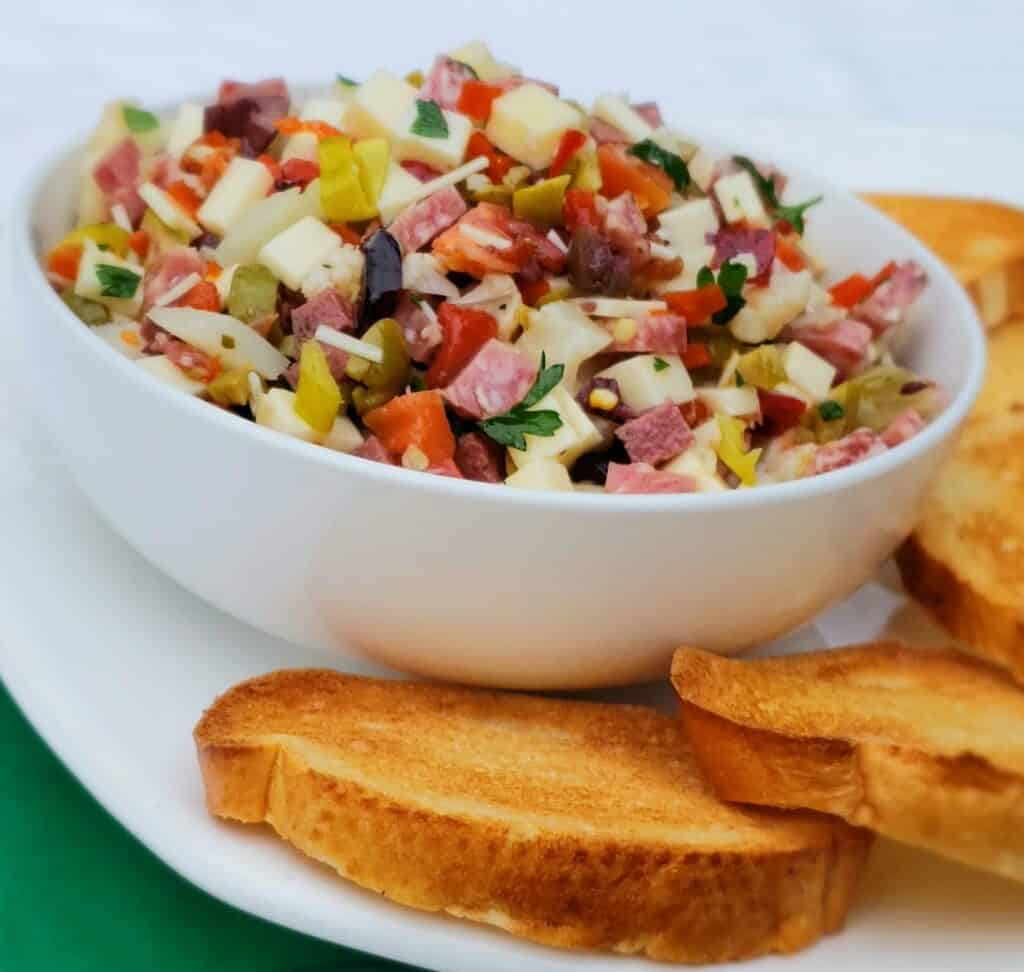 One of my favorite recipes to use fresh parsley is Muffaletta Dip. All the meats, cheeses, olives, and pickled vegetables chopped up in a dip. Serve them with toasted French bread slices or pita chips.