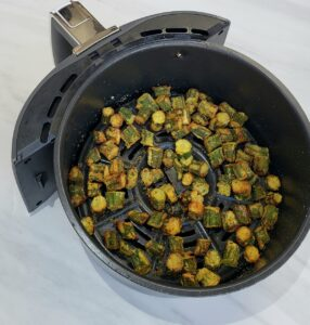 Fried okra in air fryer basket