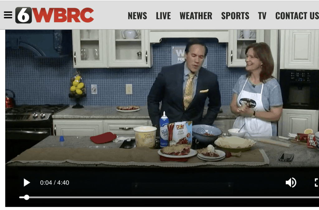 Chef segment image of Grits And Gouda's Kathleen Phillips making Shortcut Strawberry Rhubarb Pie with host Mike Dubberly