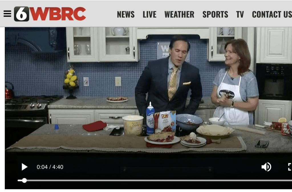 Tv host and woman making Shortcut Strawberry Rhubarb Pie