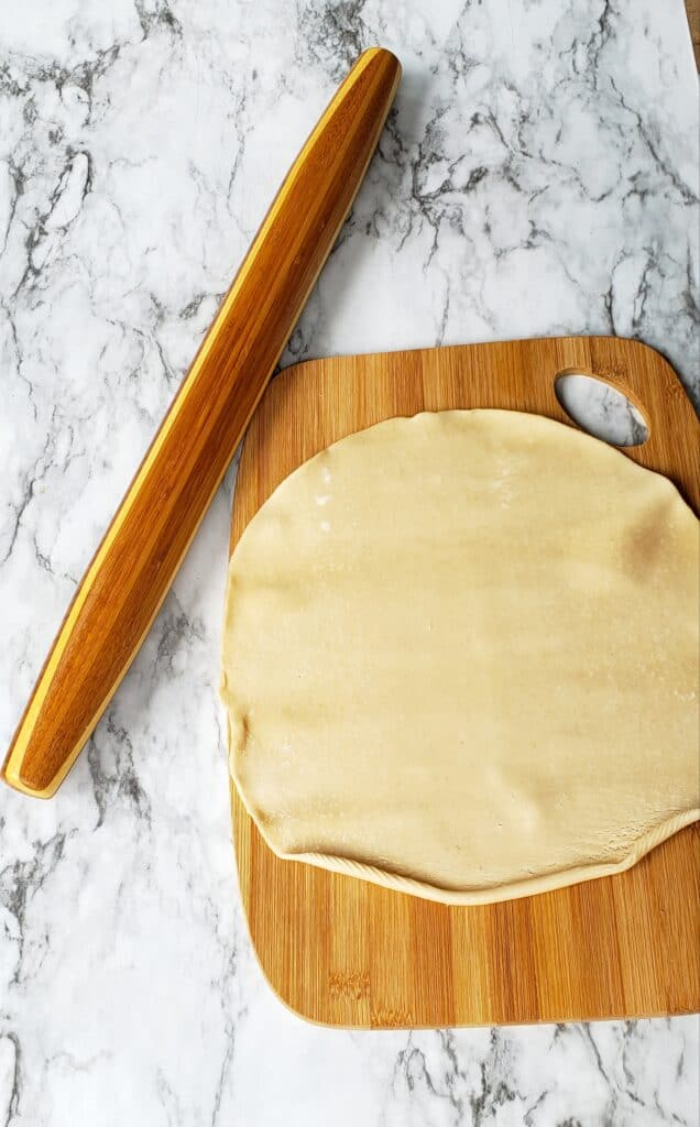 Smooth out the curled edges of the pie dough but don't be tempted to roll it out the refrigerator pie dough any thinner.