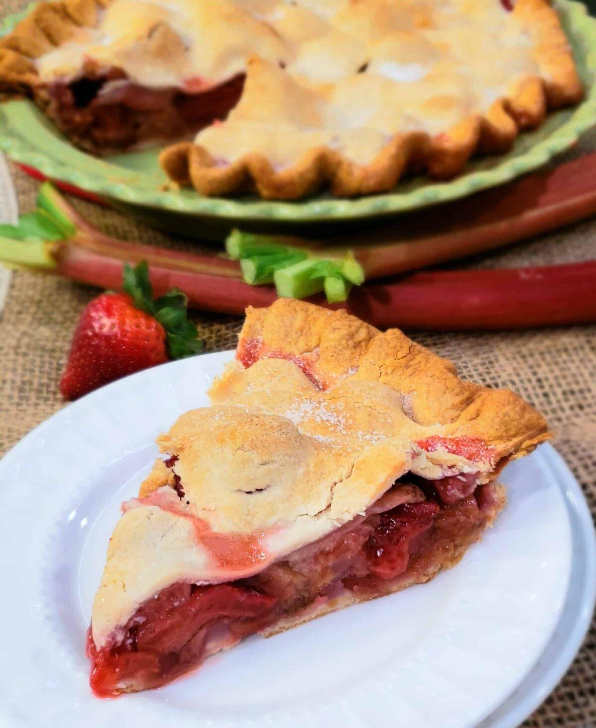 Shortcut Strawberry Rhubarb Pie sliced on a white plate
