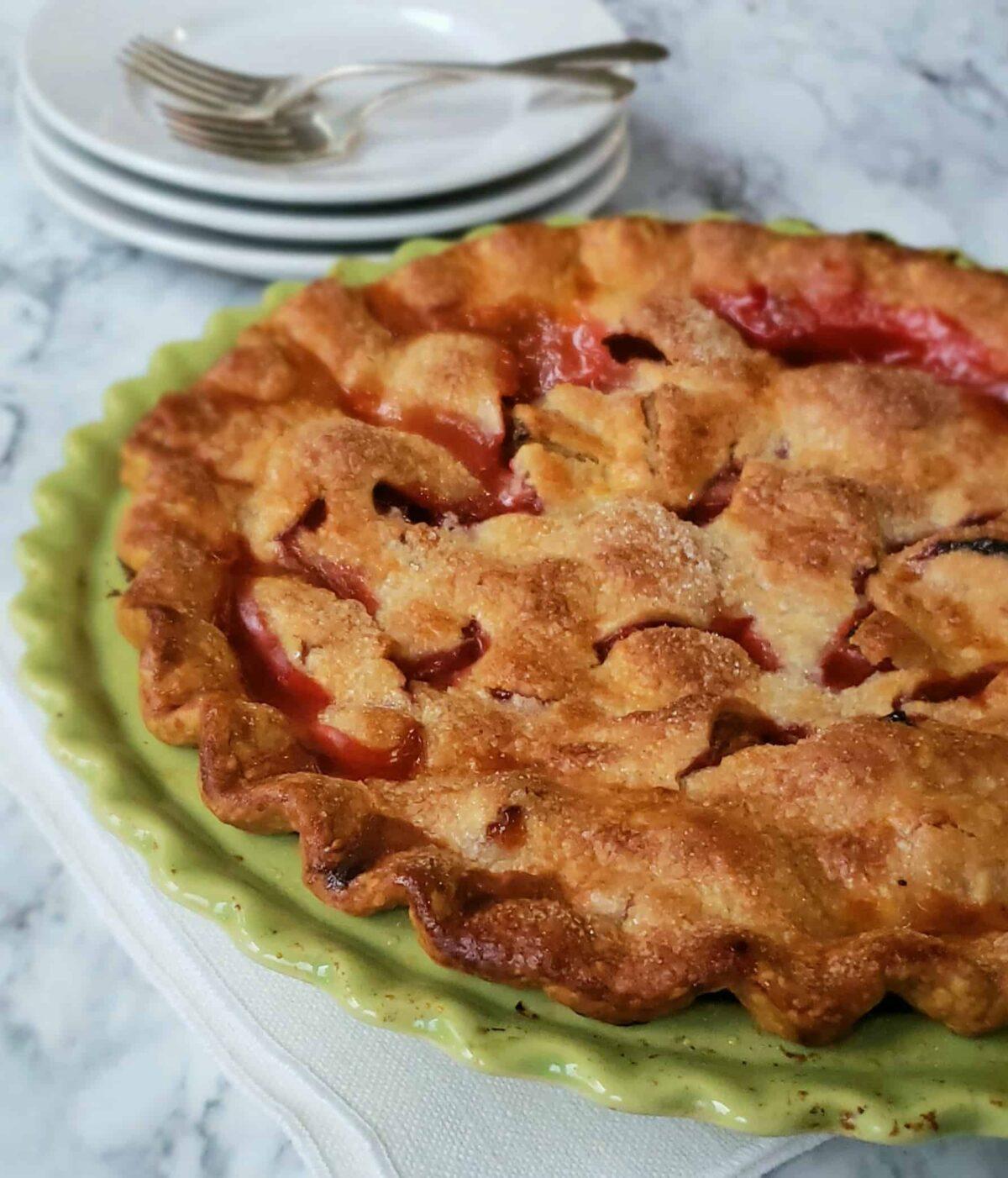 Shortcut Strawberry Rhubarb Pie uncut on green pie plate