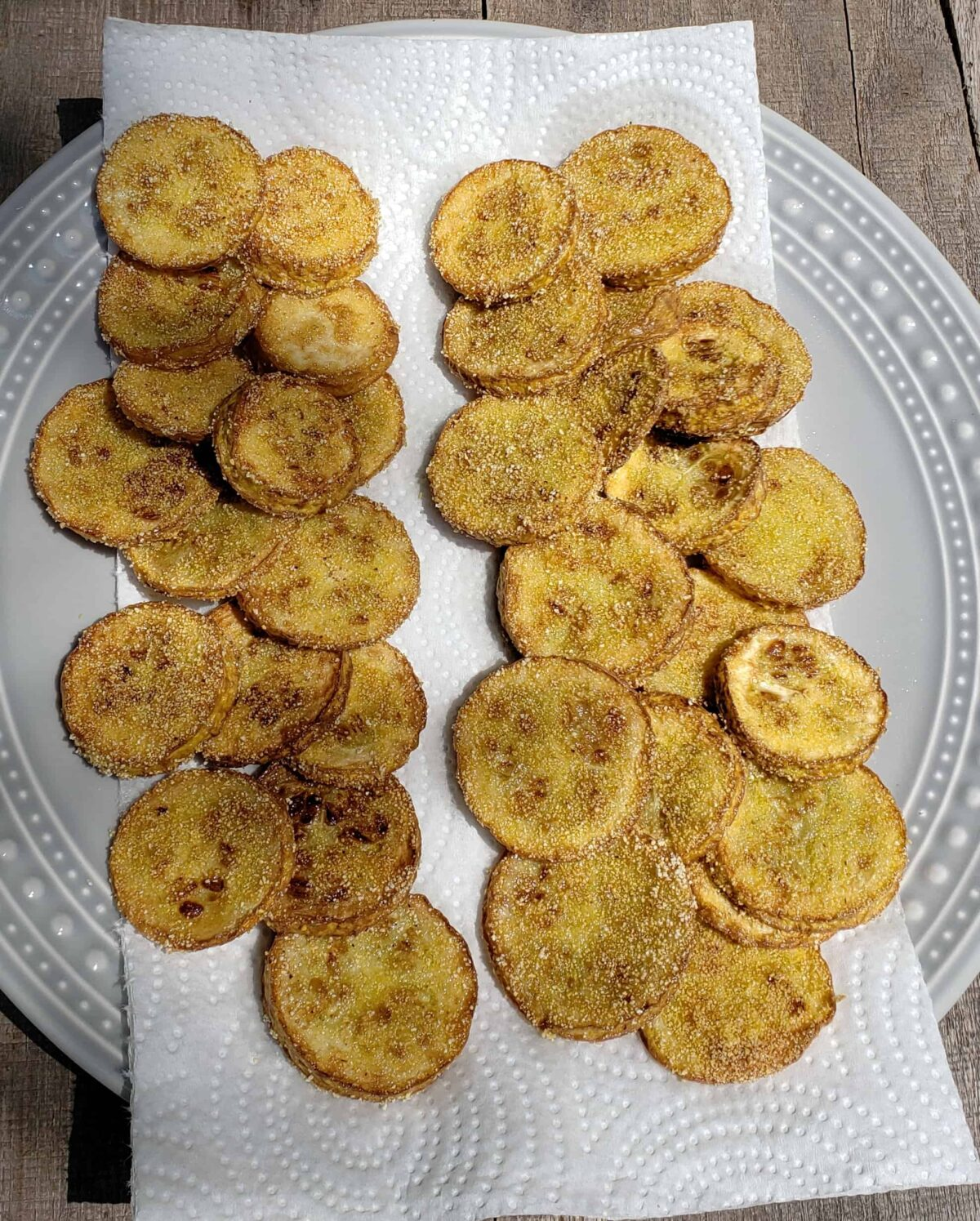 Fried yellow squash comparing coating cornmeal and cornmeal/flour side by side