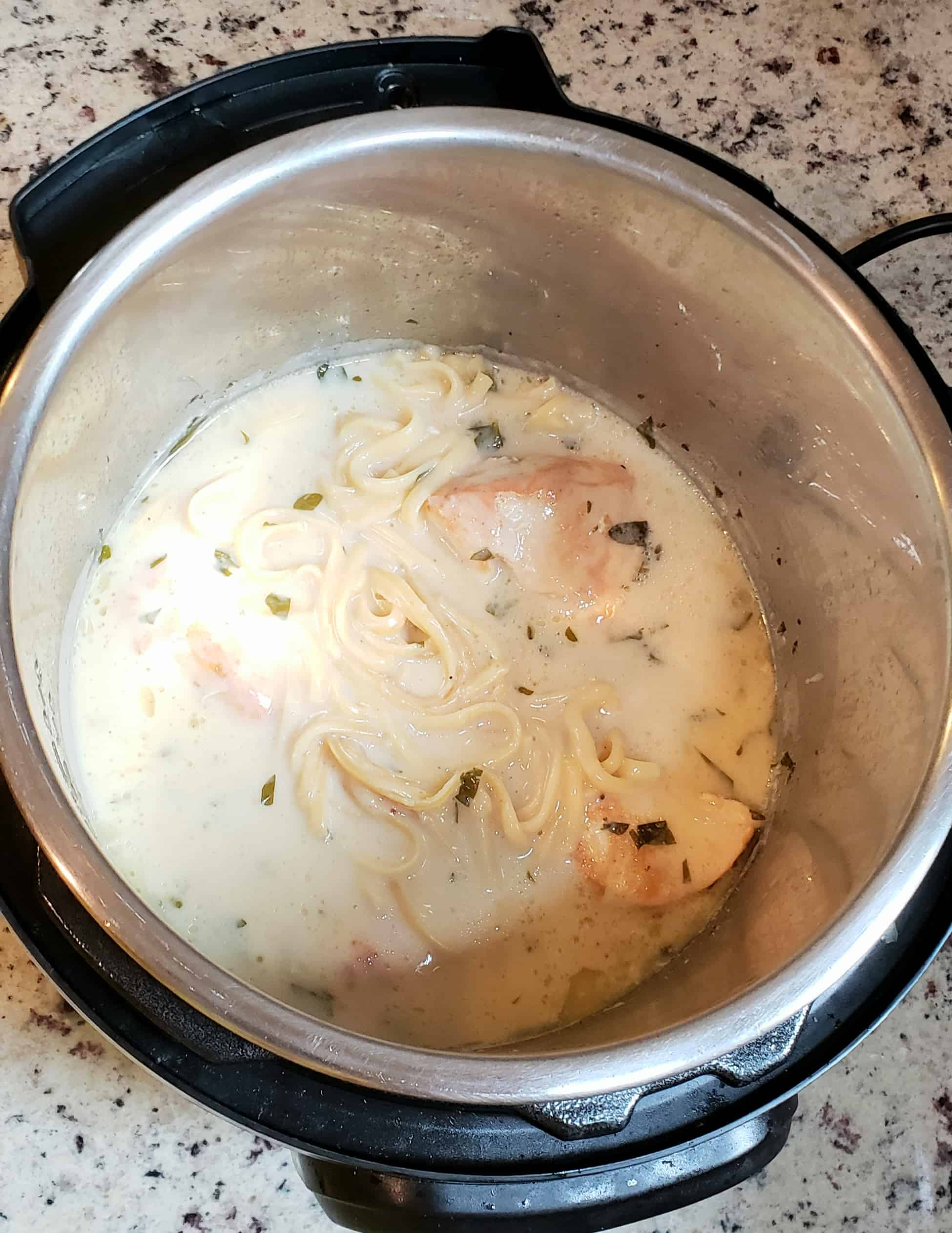 liguine chicken and alfredo sauce overheaad view in Instant Pot