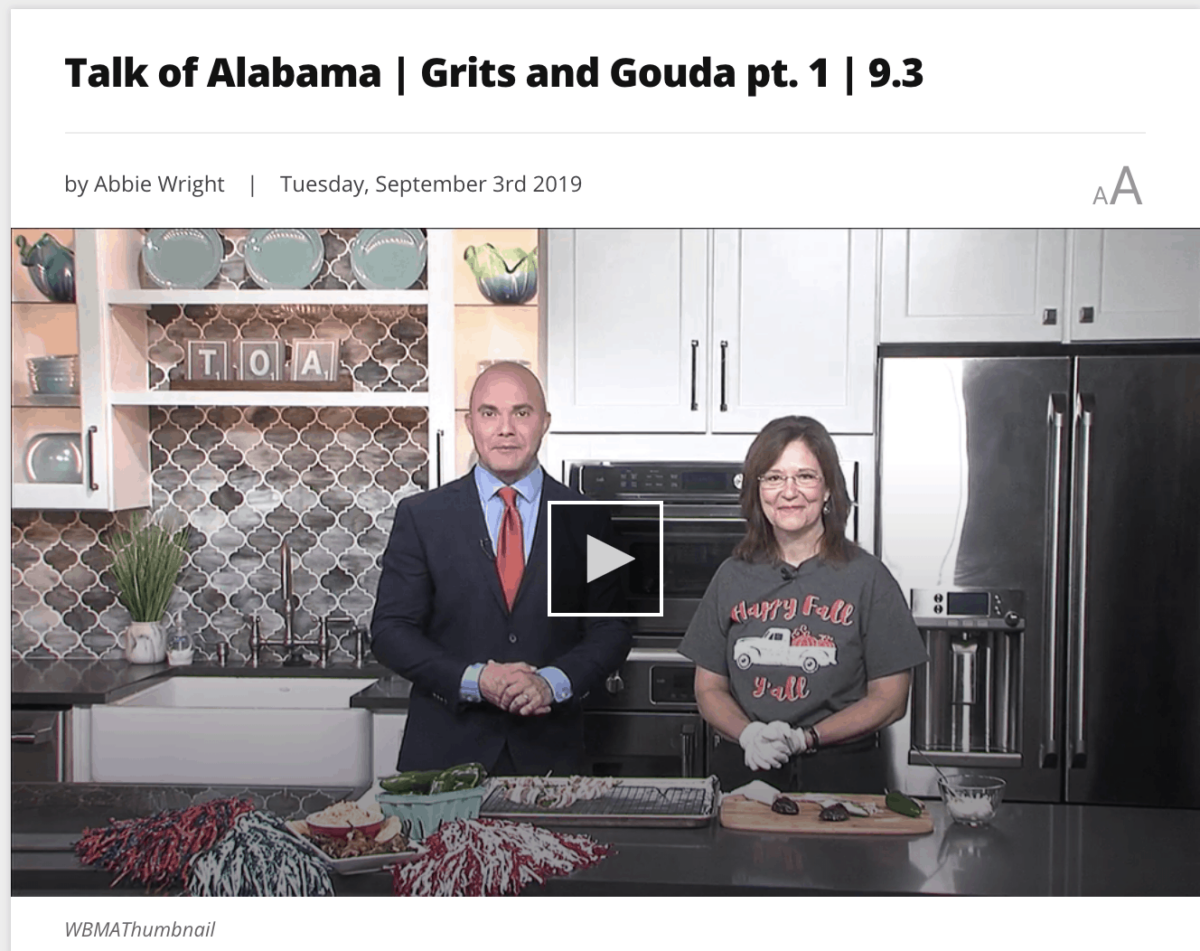 Video clip picture of man in suit and woman in t shirt on tv kitchen set