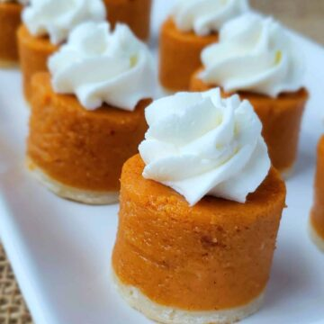 pumpkin pie cut out in circles with whipped cream