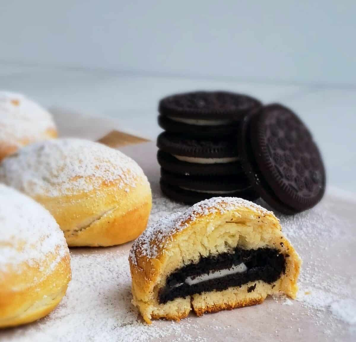 air fryer Oreos with stack of cookies behind one cut in half