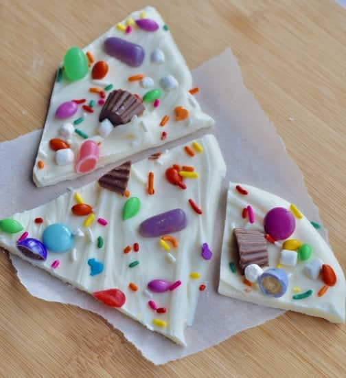 3 pieces of Easter chocolate bark on a piece of parchment paper