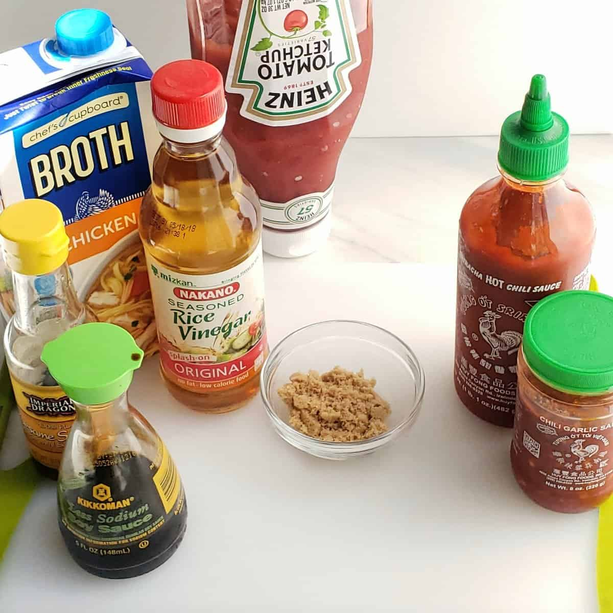 bottles of asian ingredients on a white cutting board