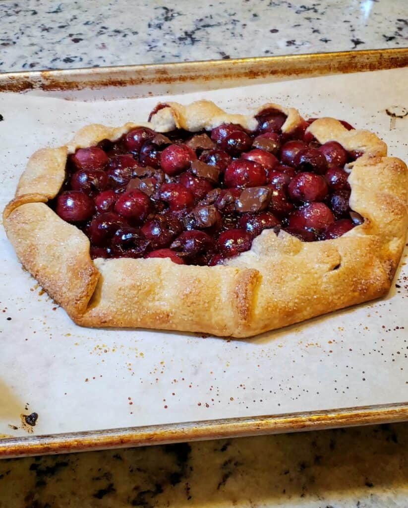 baked chocolate cherry galette on parchment