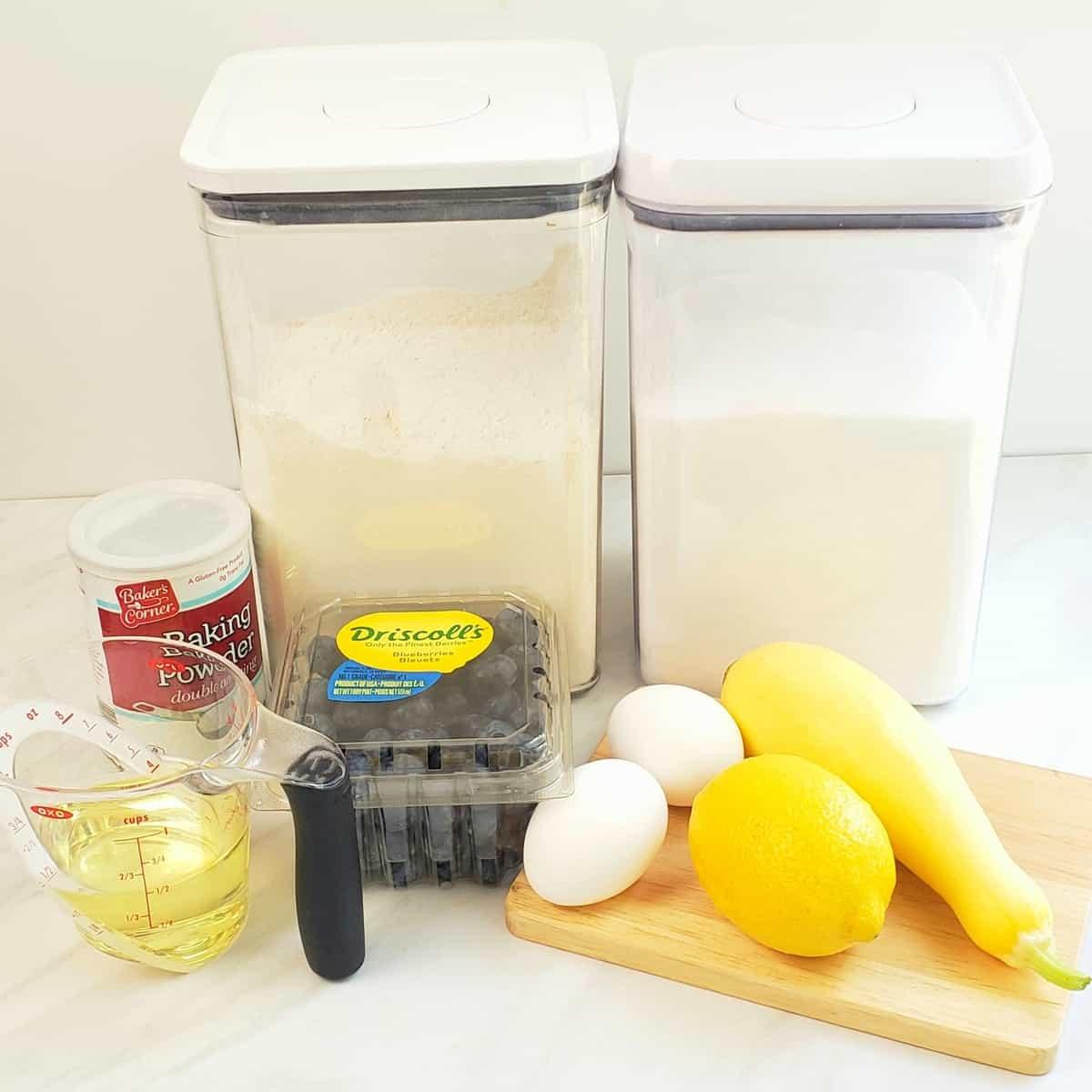 ingredients: flour, sugar, eggs, baking powder, blueberries, lemon, yellow squash, oil