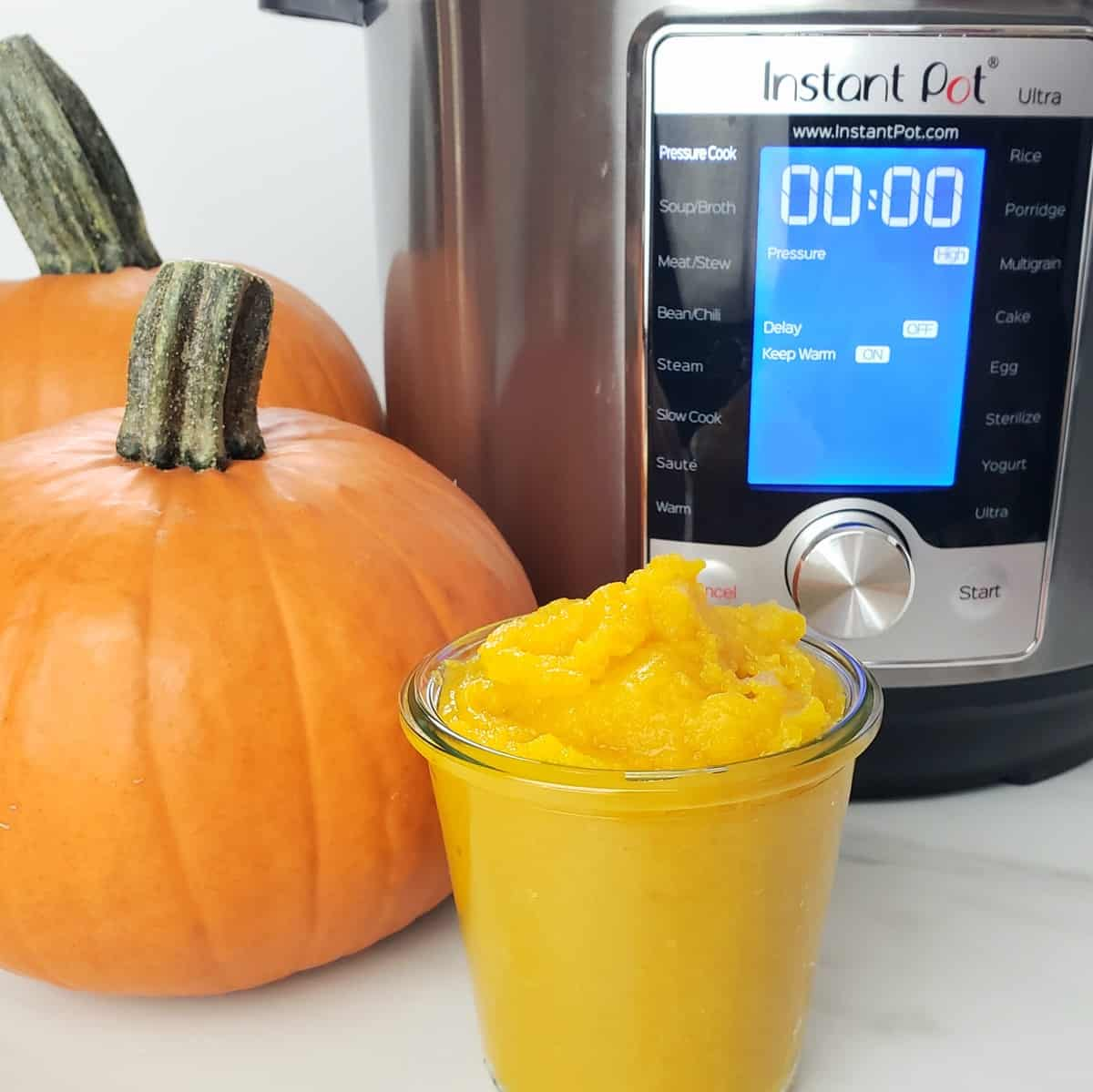pumpkin beside an Instant Pot