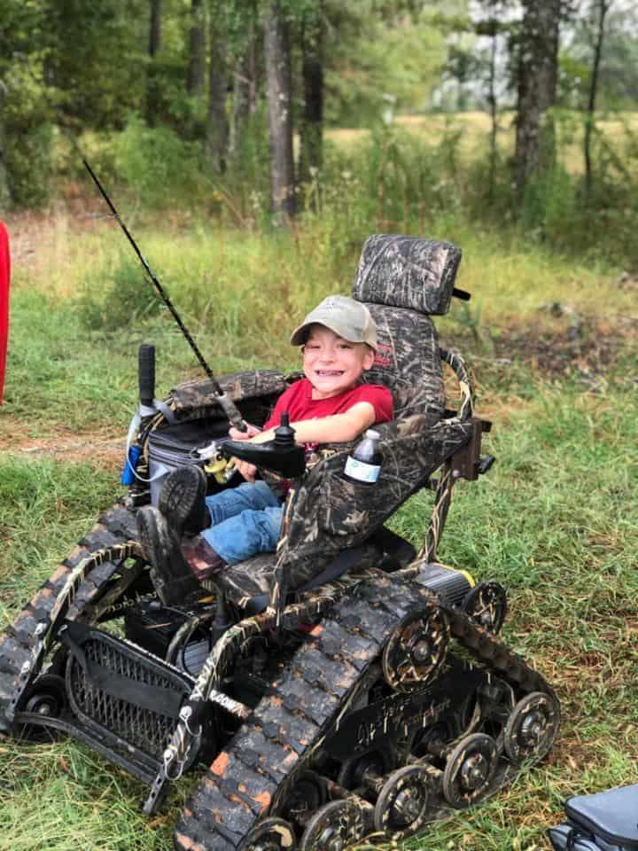 boy in tank-like wheelchair