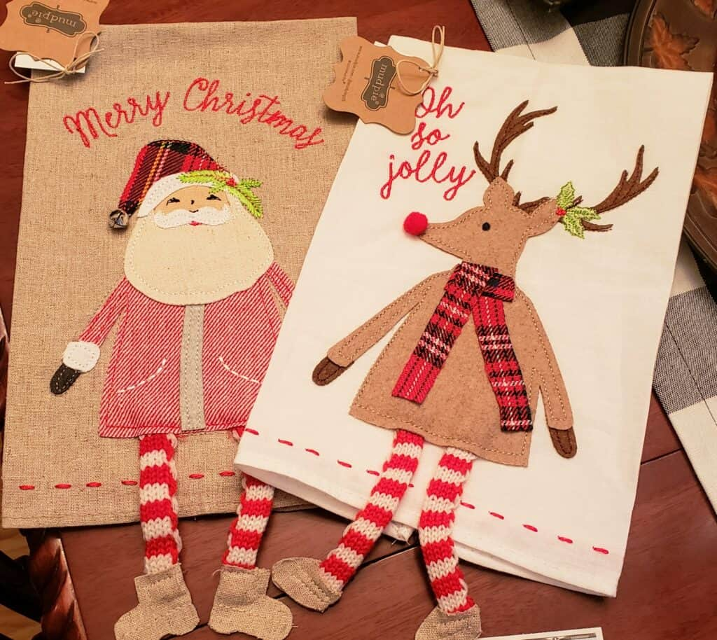 two kitchen towels wtih santa and a reindeer