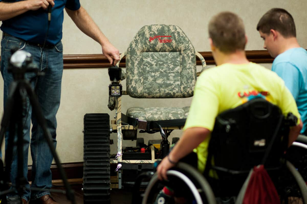 Action Track Chair, boy in wheelchair lookin on