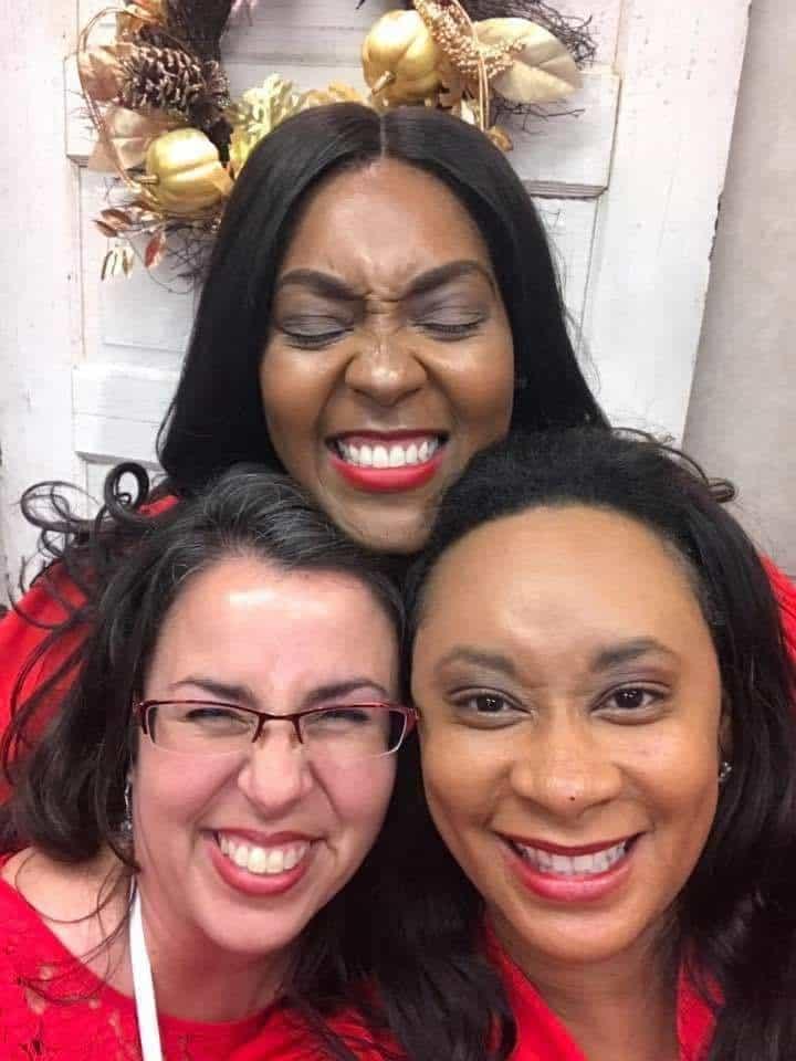 three ladies faces close together