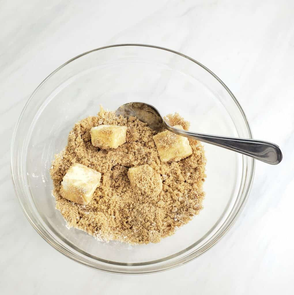 Combining butter and brown sugar in a glass bowl