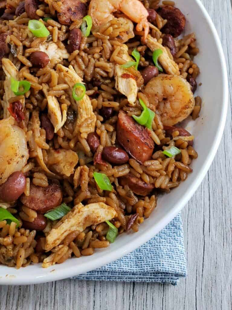 Jambalaya in a white bowl with chicken sausage and shrimp